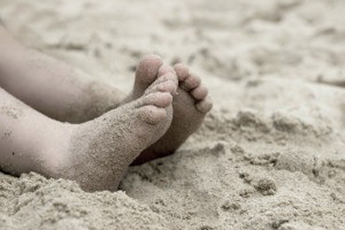 Childs-feet-in-sand